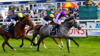 Capri and Ryan Moore land the St Leger from Crystal Ocean (left) and Stradivarius