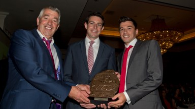 Michael McConville (right) and his father Stephen (left) accept the Red Mills champion point-to-pointer award for Anseanachai Cliste from John Gerety of Red Mills (centre) in 2016