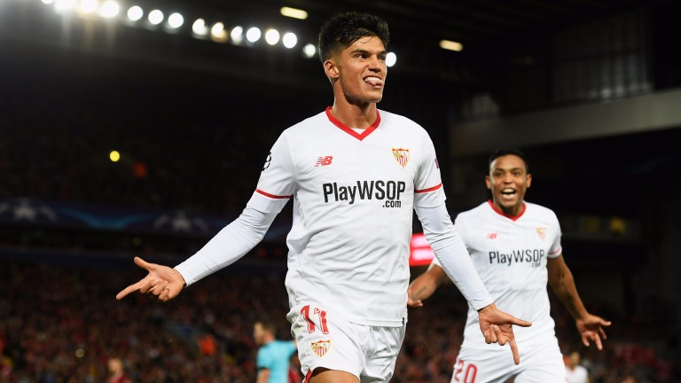 Joaquin Correa celebrates scoring for Sevilla against Liverpool