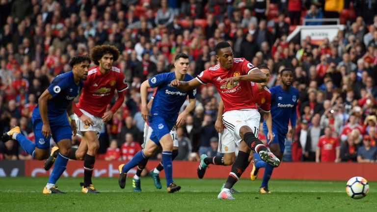 Anthony Martial scores from the spot against Everton