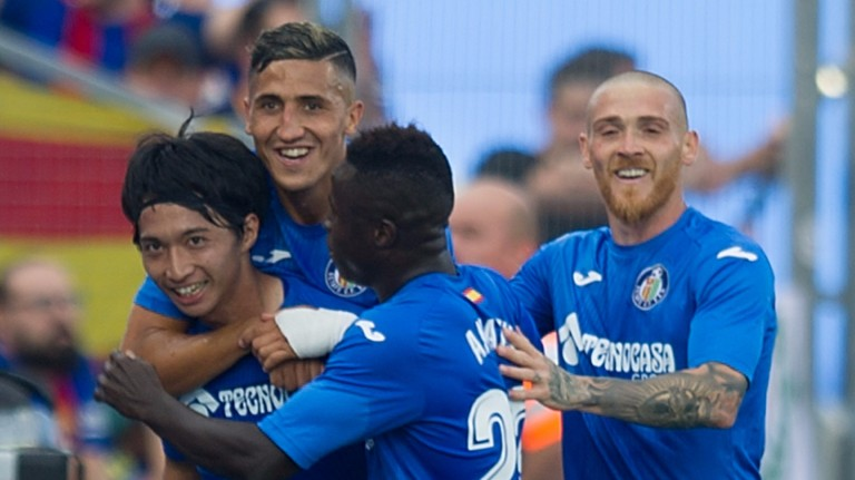 Getafe celebrate a goal against Barcelona