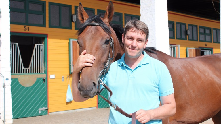 Markus Klug pictured with his 2014 Deutsches Derby winner Sea The Moon