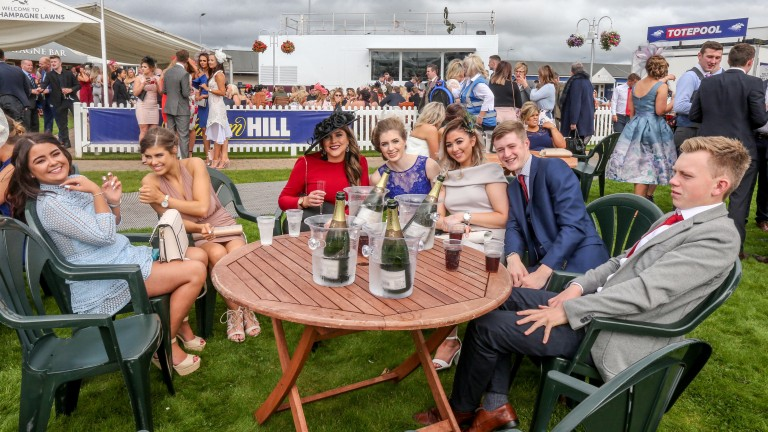 All dressed up with somewhere to go: season ticket holders flocked to Ayr undeterred by the lack of racing