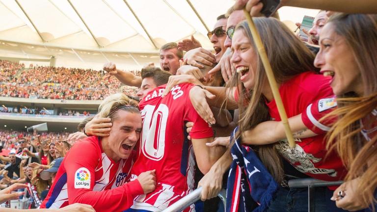 Atletico celebrate their win over Sevilla