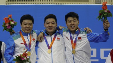 Tian Pengfei (centre) celebrates with his pals Ding Junhui and Liang Wenbo