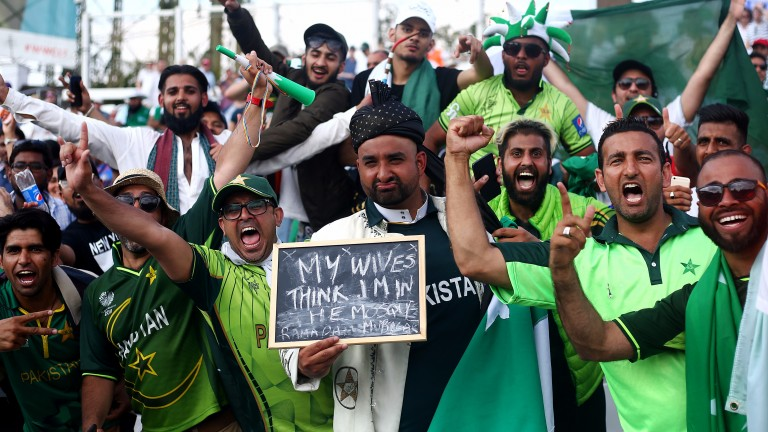 Pakistan fans cheer on their team