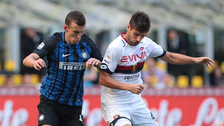 Genoa's Miguel Velosa (right) tussles with Inter's Ivan Perisic