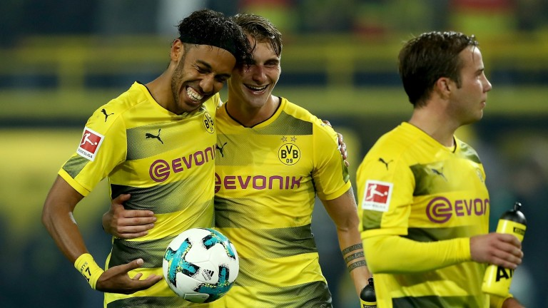 Pierre-Emerick Aubameyang collects the match ball after a hat-trick for Borussia Dortmund