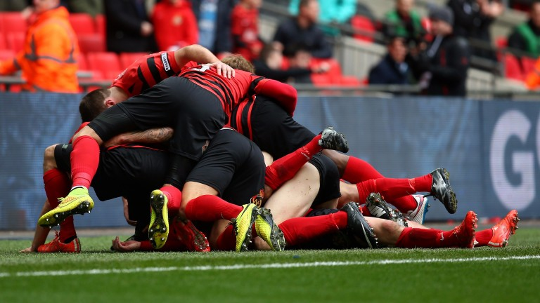 Wrexham pile on after scoring a goal