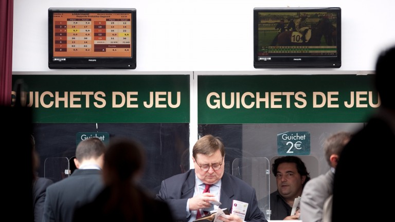 Punters que to place their pari-mutuel bets on Arc day in 2012