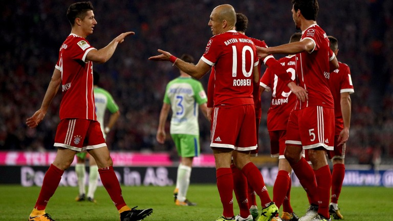 Arjen Robben celebrates a goal with Bayern Munich teammates
