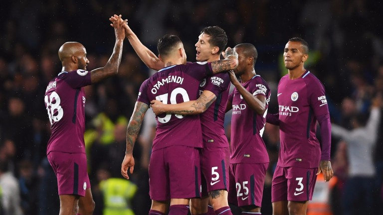 Man City celebrate their win at Chelsea