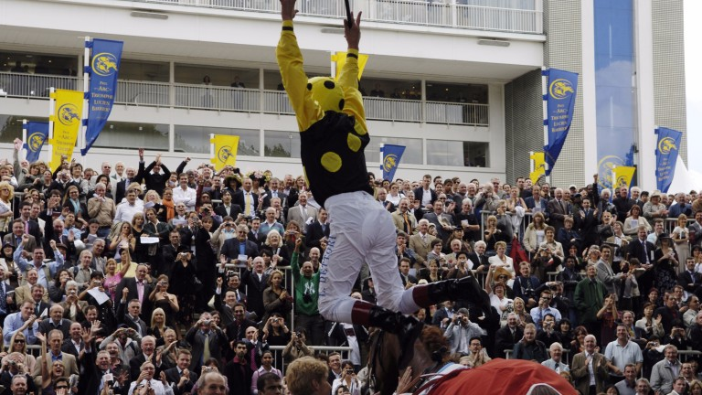 Frankie Dettori celebrates with a flying dismount after Group 1 triumph in the 2006 Prix du Cadran