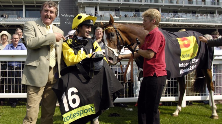 Owner Terry Cooper with jockey Alan Munro after victory in the 2005 Ebor