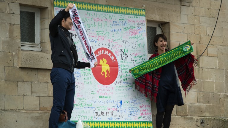Flying the flag: superfans show their support for Japanese Arc runner Satono Diamond