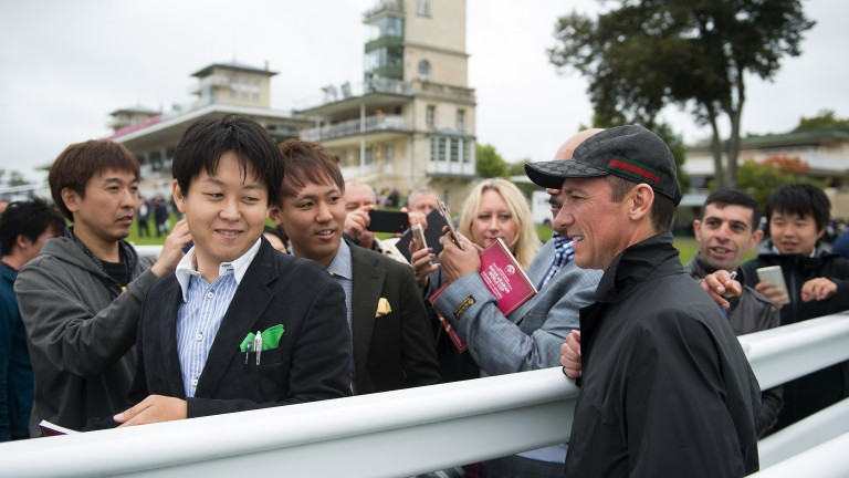 Man in demand: Chantilly racegoers flock to get a glimpse of Enable's jockey Frankie Dettori