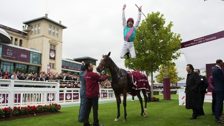 Fabulous five: Frankie Dettori, who sealed his fifth Arc win with victory on Enable, delights the crowd with a flying dismount