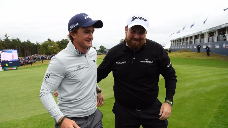 Paul Dunne (left) celebrates his British Masters win with pal Shane Lowry last week
