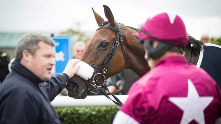 Gordon Elliott pats Death Duty after his chase debut at Tipperary
