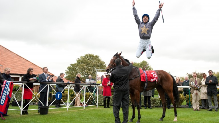 Frankie Dettori performs a flying dismount from Never Can Tell after winning the Cambridgeshire