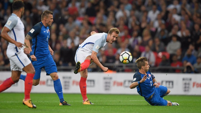 Harry Kane has a pop at goal against Slovakia