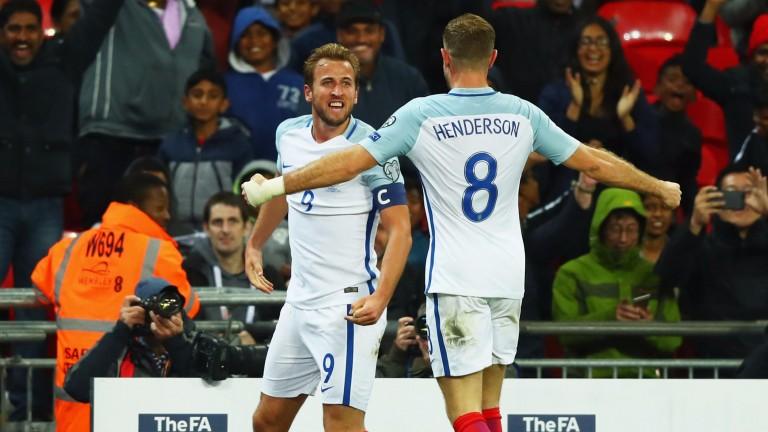 Jordan Henderson celebrates with England hero Harry Kane