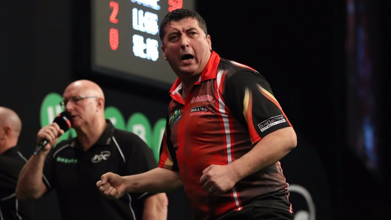 Mensur Suljovic celebrates a checkout against Peter Wright in Dublin