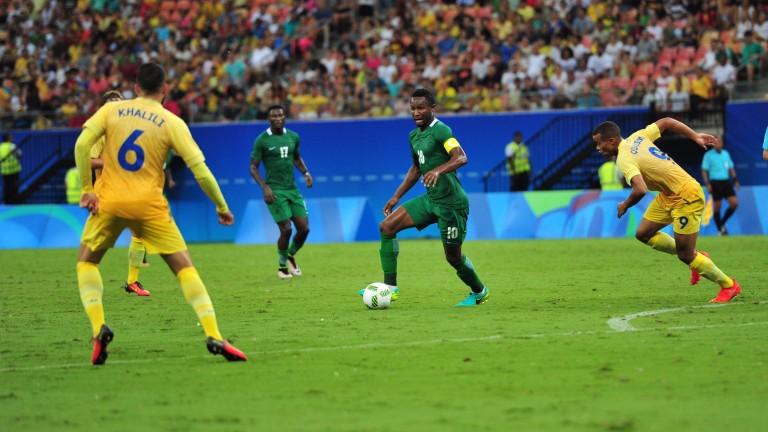 Nigeria's John Obi Mikel controls the ball against Sweden