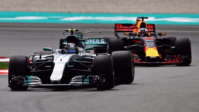 Valtteri Bottas leads Daniel Ricciardo's Red Bull in Malaysia