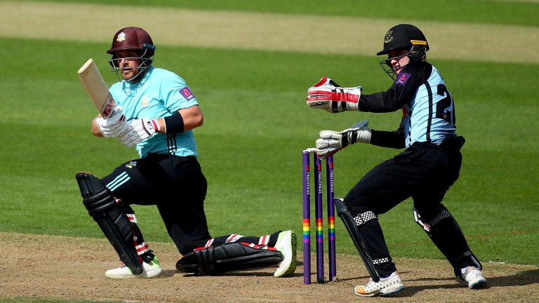 Australia opener Aaron Finch slog-sweeps for Surrey against Sussex
