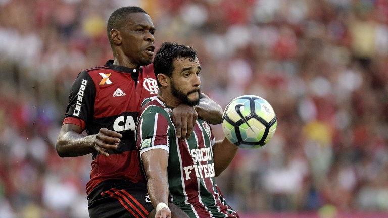 Flamengo's Juan (left) battles with Fluminense's Henrique Dourado at the Maracana in June