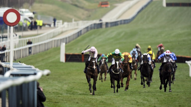 Mikael D'Haguenet (left) wins the Ballymore Properties Novices' Hurdle at Cheltenham in 2009, the final year of the firm's sponsorship.