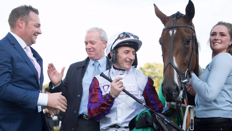 Put it there, pal: John Dance (left) shakes hands with trainer Karl Burke in the winner's enclosure