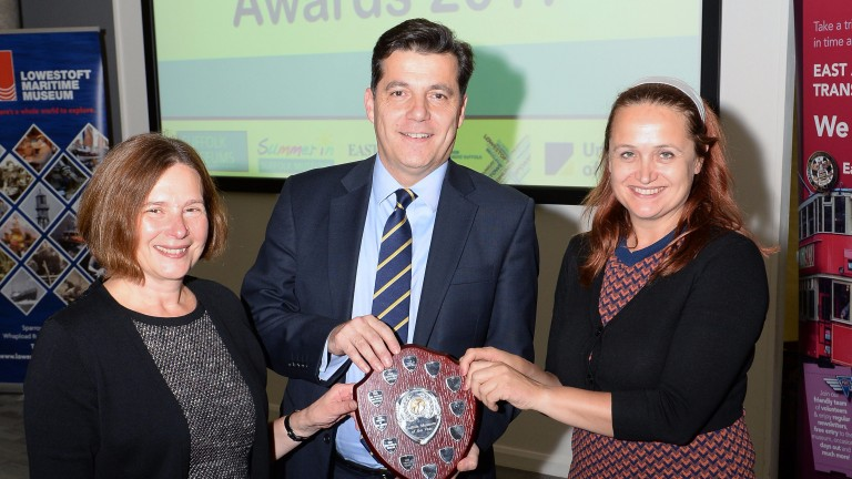 Chris Garibaldi receives the trophy for Suffolk Museum of the Year