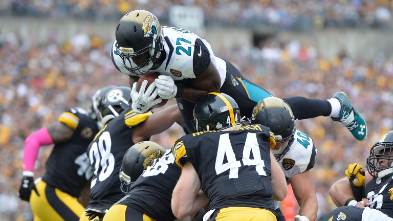 Jacksonville's Leonard Fournette dives into the end zone against Pittsburgh