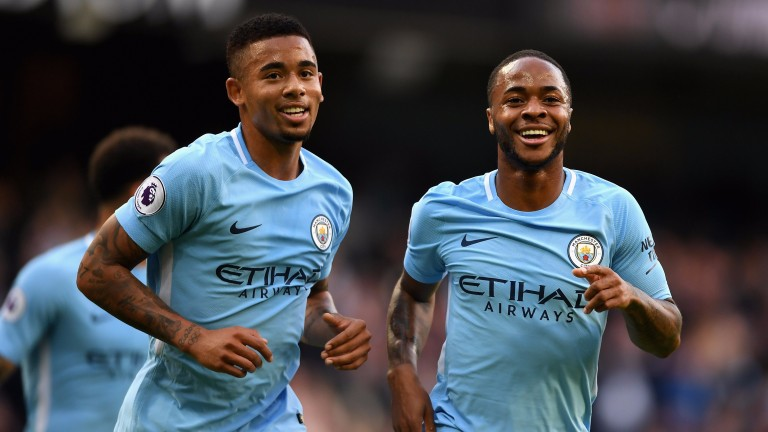 Man City's Raheem Sterling (right) and Gabriel Jesus