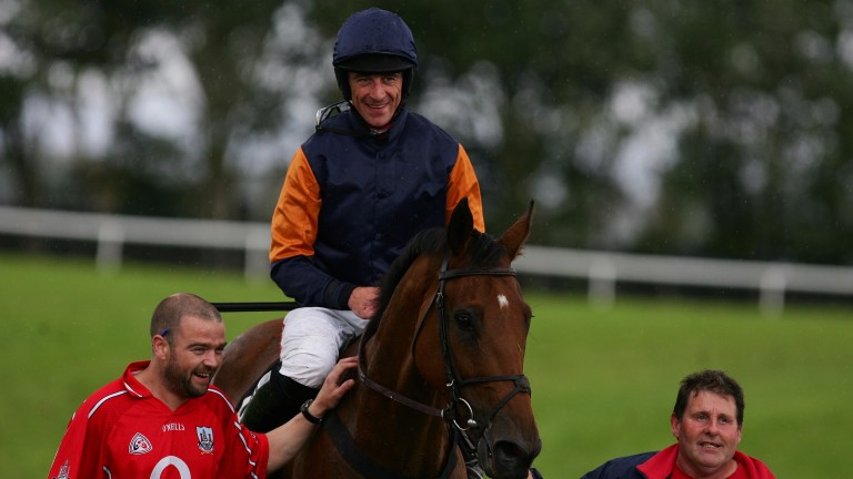 Rebel Fitz and Davy Russell win the Galway Hurdle for Michael Winters in 2012