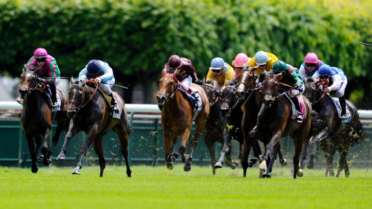Avenir Certain (second left) win the 2014 Poule d'Essai des Pouliches at Longchamp