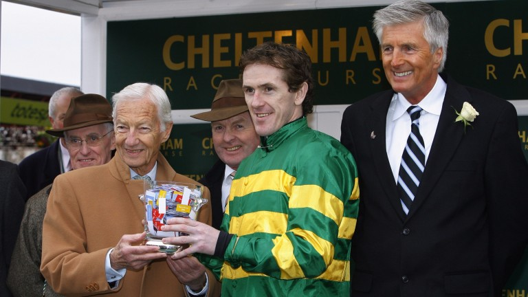Michael Dickinson (right) watches on as Lester Piggott presents Sir Anthony McCoy with a trophy at Cheltenham in March 2009