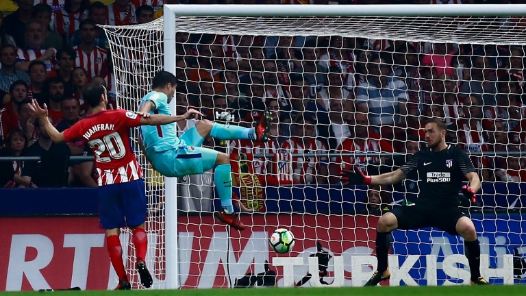 Luis Suarez scores Barcelona's equaliser at Atletico last Saturday