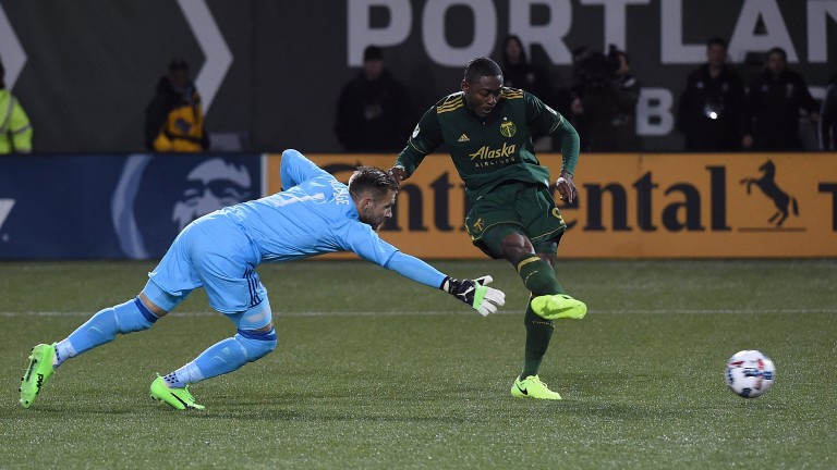 Fanendo Adi of Portland Timbers scores against Minnesota United