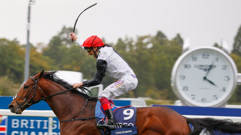 Frankie Dettori raises his whip in triumph passing the post in the Champion Stakes