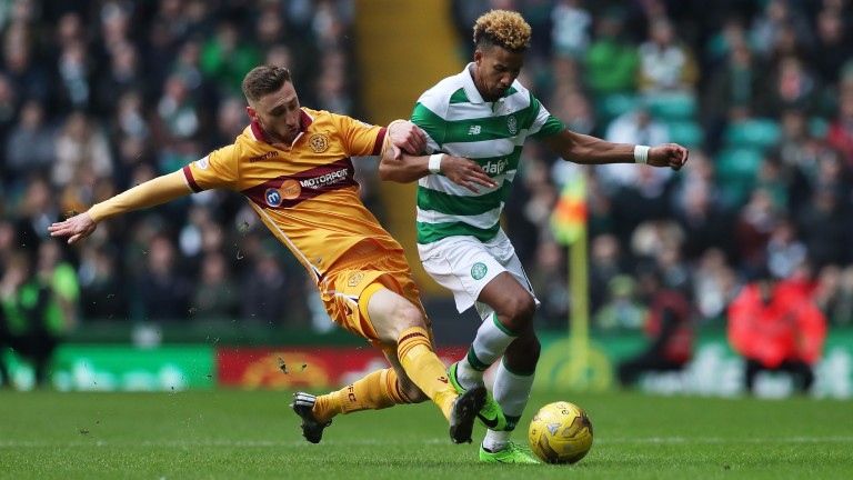 Louis Moult of Motherwell vies with Scott Sinclair of Celtic