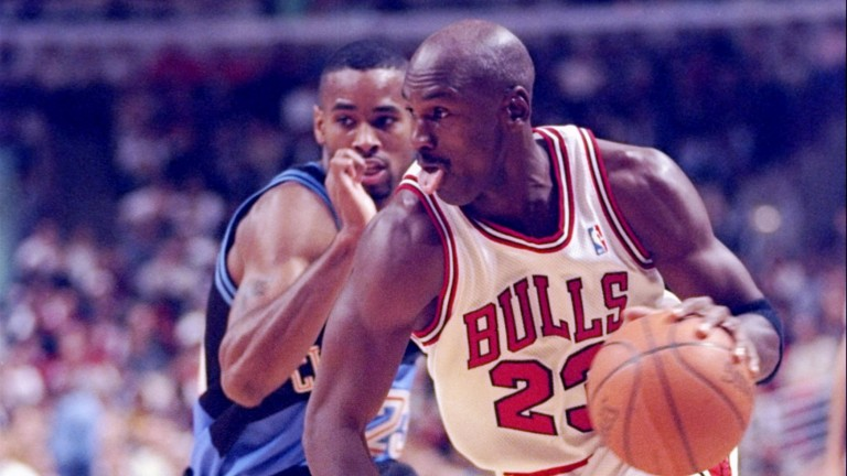 In 1997 Cleveland slowed it down to surprise Chicago and Michael Jordan (right) 73-70