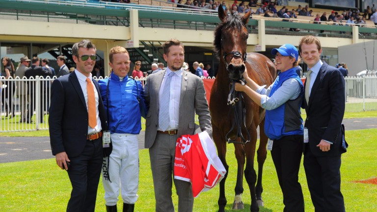 Godolphin groom Carey Williamson (second right) with connections after Qewy's win at Sandown in Melbourne last year