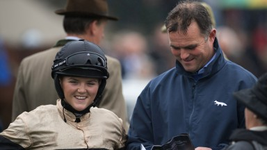 Family affair: Isabel Williams prepares to take the mount on Theatre Stage for her father Evan in the opening amateur riders' handicap hurdle