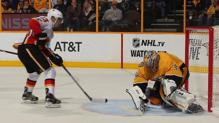 Calgary's Johnny Gaudreau challenges Nashville goalie Pekka Rinne