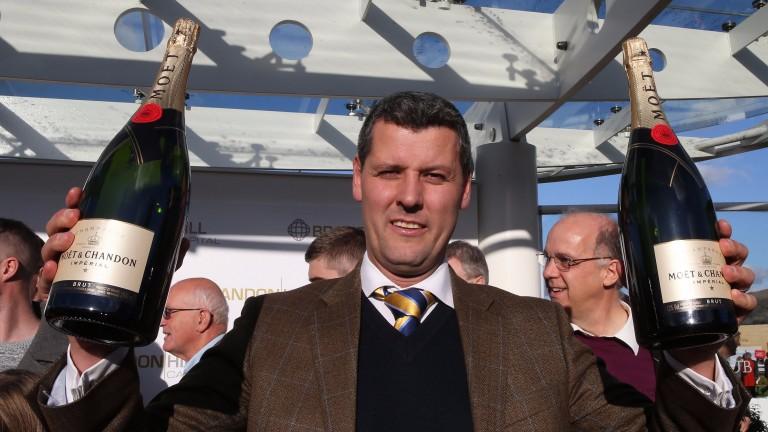 Tim Vaughan celebrates his first Cheltenham winner
