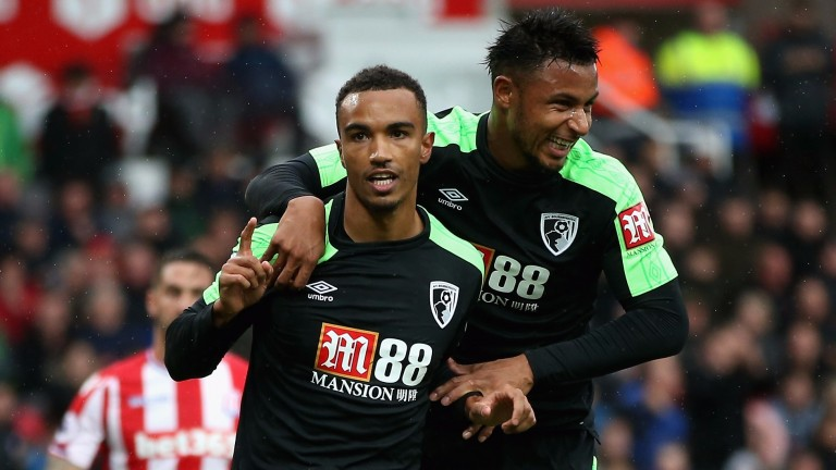 Junior Stanislas (left) earned Bournemouth a 2-1 win at Stoke