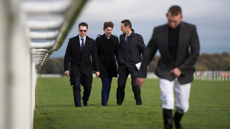 Walking the track: Aidan O'Brien (far left) assesses conditions ahead of the Racing Post Trophy